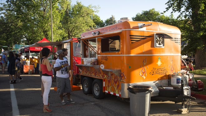 The Pineapple Express food truck at day one of 18th annual Taste of Fort Collins at Civic Center Park Friday, June 13, 2014. The festival continues through Sunday.