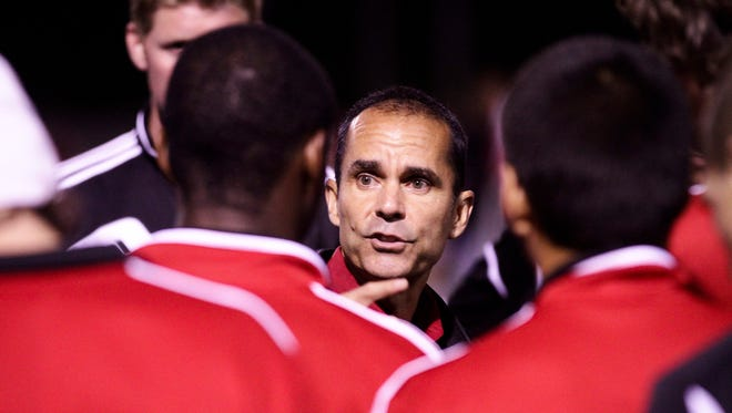 University of Louisville head coach Ken Lolla talks with his team after a 2012 game against UK at Cardinal Park.