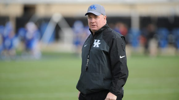 Head Coach Mark Stoops during a University of Kentucky football spring practice at the Nutter Training Facility in Lexington, KY. Wednesday, April 2, 2014.