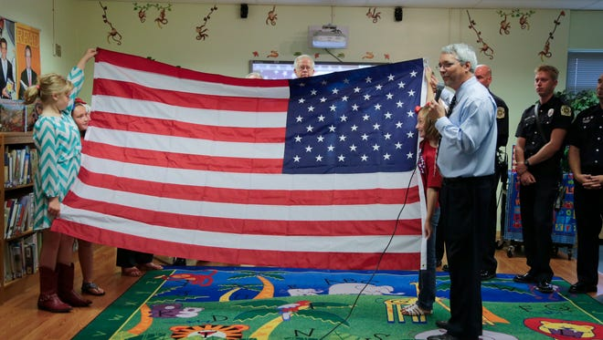 A 2014 file photo of Tim Hagan, then the principal of Hite Elementary School, during Hite's Patriot Day activities.