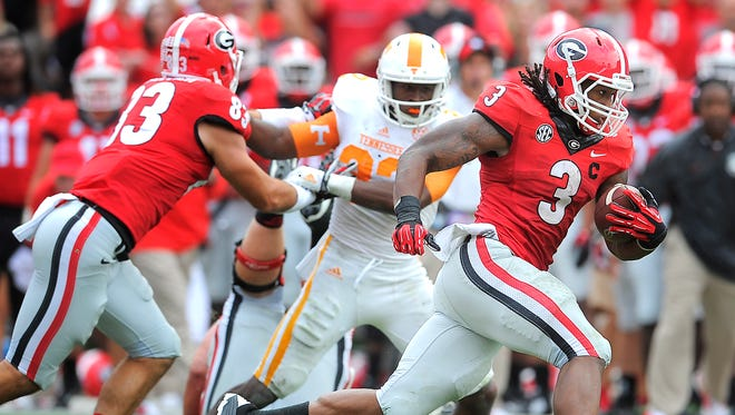 Georgia tailback Todd Gurley (3) break into open field against Tennessee.