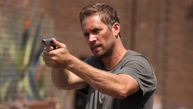 """Paul Walker in a scene from """"Brick Mansions."""""""