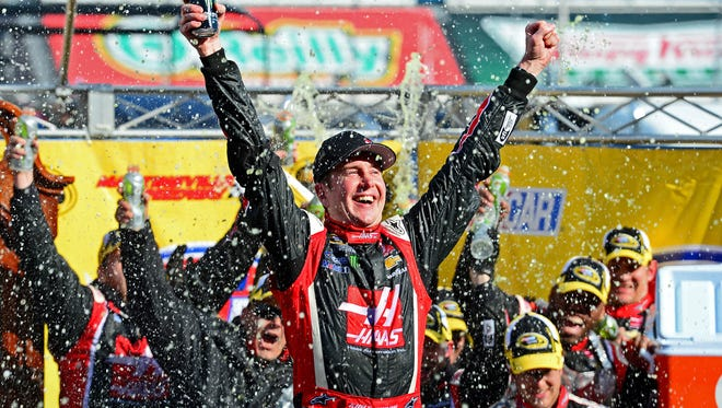 NASCAR Sprint Cup Series driver Kurt Busch celebrates in victory lane after winning the STP Gas Booster 500 at Martinsville Speedway on March 30, 2014.
