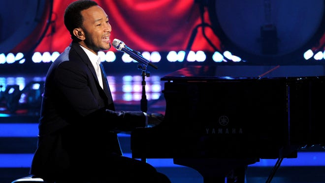 """Singer John Legend performs onstage during Fox's """"American Idol"""" XIII Finale at Nokia Theatre L.A. Live on May 21, 2014, in Los Angeles."""