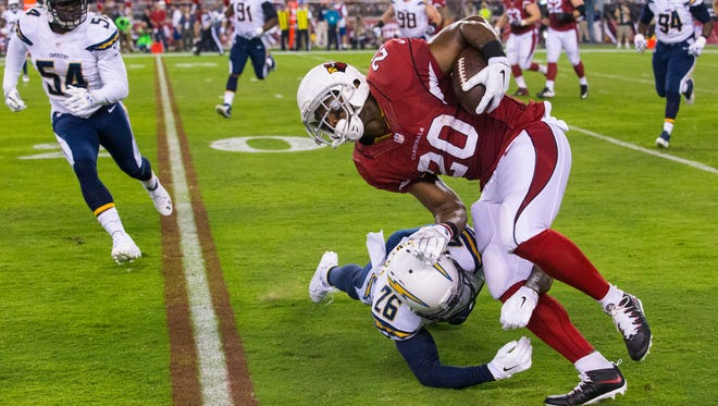 Arizona Cardinals running back Jonathan Dwyer (20) tries to get past San Diego Chargers defensive back Brandon Flowers during a game on Monday, Sept. 8, 2014, in Glendale. Dwyer voucheed for new practice squad running back Chris Rainey, who been in trouble in the past.