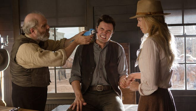 "From left, Jay Patterson, Seth MacFarlane and Charlize Theron star in ""A Million Ways to Die in the West."""