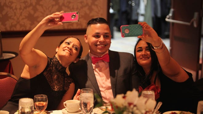 "From left, Claribel Oliveras, Shalym Nater, and Nilda Leon share a ""selfie"" Friday during the Latinas Unidas gala."