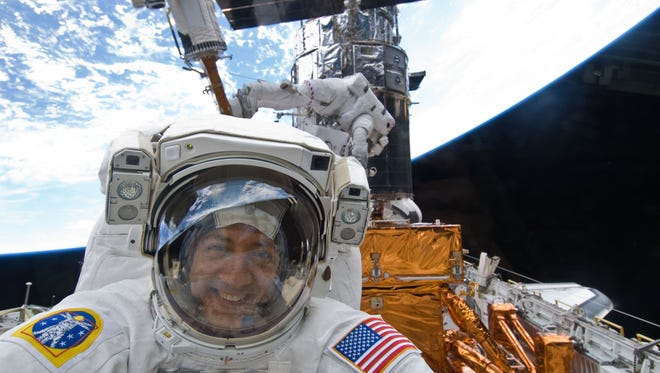 "Michael Massimino, a NASA astronaut, is a veteran of two space missions, both of which serviced the Hubble Space Telescope.  George Clooney'??s character in the new movie ""??Gravity"" is thought to be based on him."