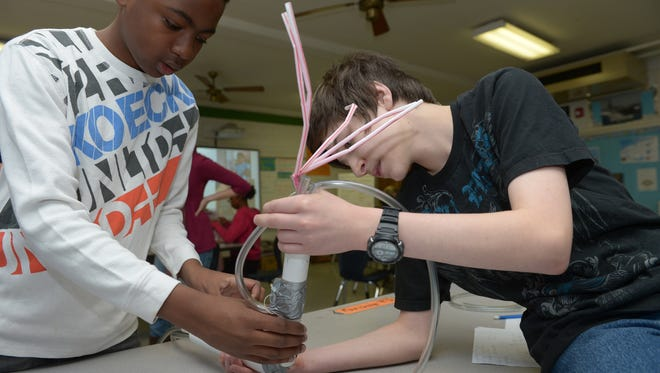 Seventh-graders construct a prosthetic arm in Burlington, N.C.