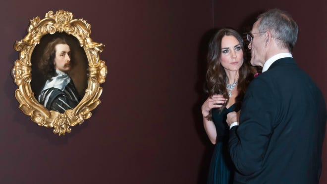 Duchess Kate of Cambridge talks to National Portrait Gallery director Sandy Nairne before 'Self-portrait' by Anthony Van Dyck, which Britain hopes to keep from leaving the country.