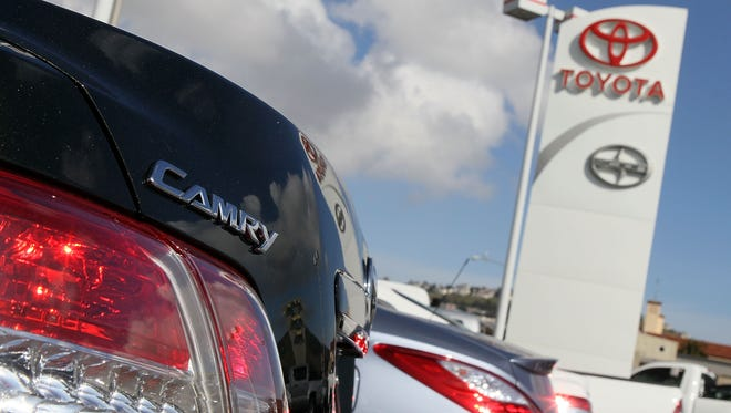 A Toyota Camry sits on the sales lot at City Toyota in Daly City, Calif., in a 2010 file photo
