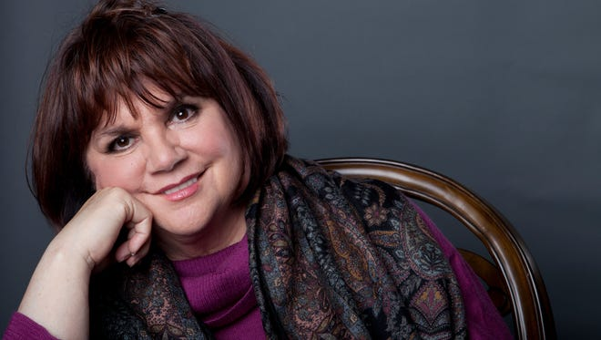 "American musician Linda Ronstadt poses in New York on Sept. 17, 2013, to promote the release of her memoirs, ""Simple Dreams."""