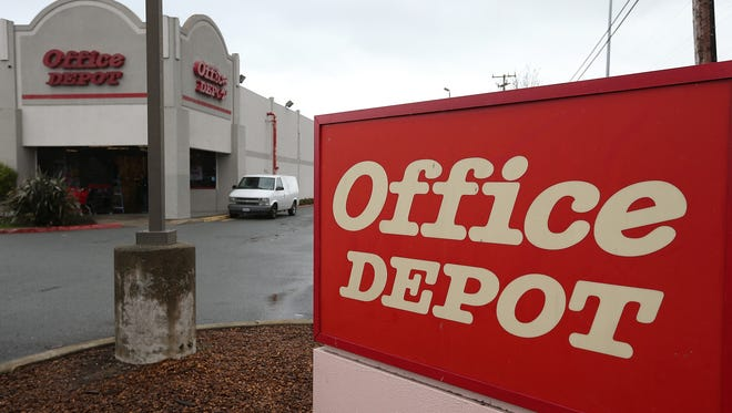 A sign is posted in front of an Office Depot store in San Rafael, Calif.