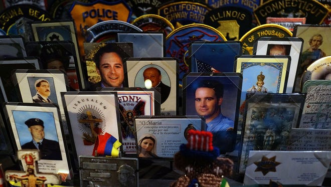 Cards, patches and mementos of those killed at Ground Zero are  viewed during a preview of the National September 11 Memorial & Museum on Wednesday, May 14, 2014.