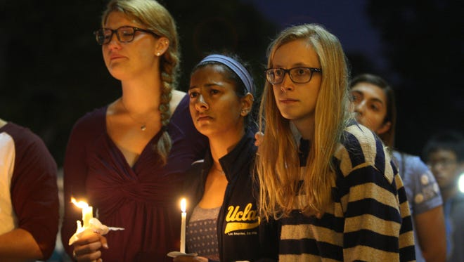 Students of UCSB and UCLA mourn at a candlelight vigil at UCLA on May 26 for the victims of a killing rampage near UCSB.