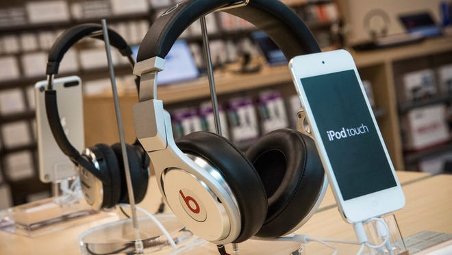 Beats headphones are sold alongside iPods in an Apple store in New York City.