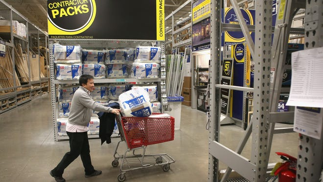 A customer shops at a Lowe's home improvement store  in Chicago.