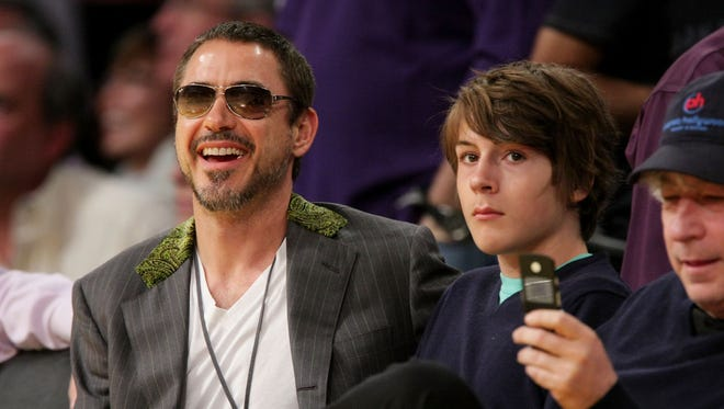 Robert Downey Jr., and his son, Indio Downey, attend a Los Angeles Lakers game at the Staples Center in 2008 in Los Angeles.