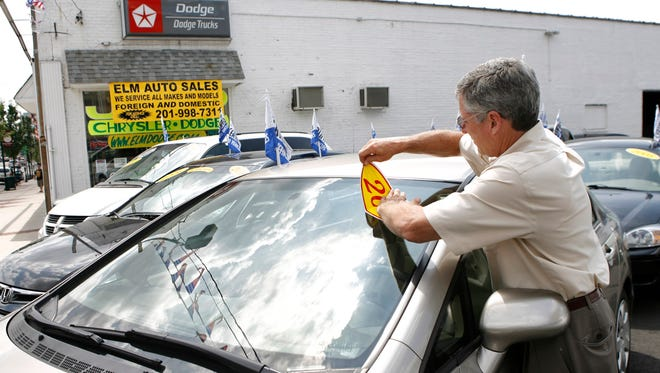 Greg Signore, owner of Elm Auto Sales, is pictured at his used car business in Kearny, N.J., in 2009.