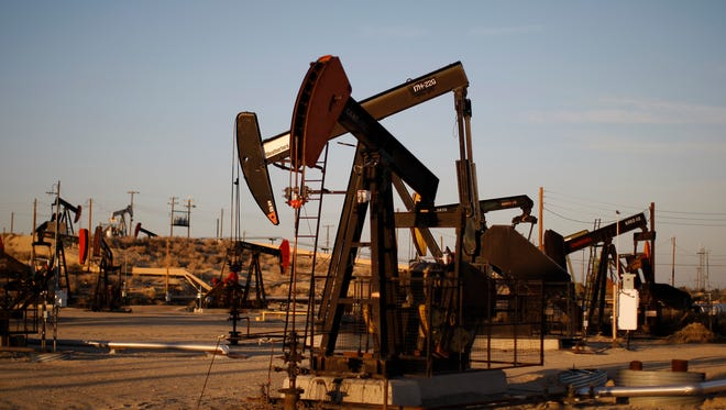 Pump jacks and wells are seen in an oil field on the Monterey Shale formation where gas and oil extraction using hydraulic fracturing, or fracking, is on the verge of a boom on March 23 near McKittrick, Calif.