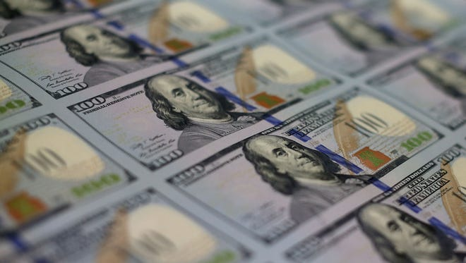 Newly redesigned $100 notes lay in stacks at the Bureau of Engraving and Printing on May 20  in Washington, D.C.