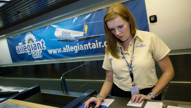 Allegiant employee Julie Bruender works at the ticket counter at Las Vegas McCarran International Airport.