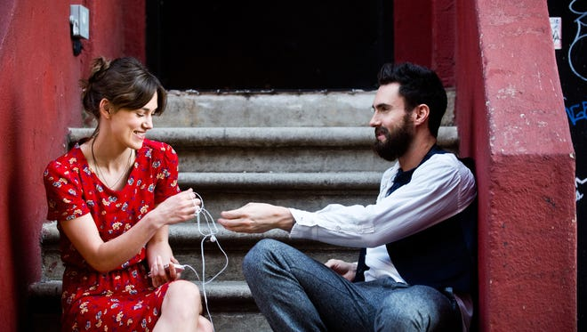 """This image released by The Weinstein Company shows Keira Knightley, left, and Adam Levine in a scene from """"Begin Again."""""""
