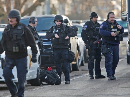 Officers suit up at a SWAT callout scene off Rockville