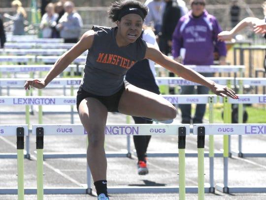 Mansfield Senior's Alaya Grose wins the 100 meter hurdles in Saturday's Lexington Invitational.