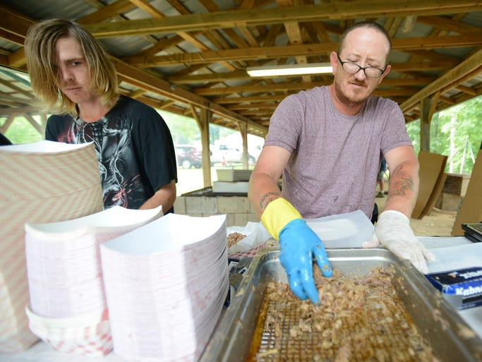 William Sills weighs meat at the annual fundraiser for the Liberty Cemetery Association Stew and Barbecue Sale at Liberty Cemetery pavilion Saturday.