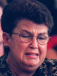Joan Hicks Landwehr, sister of Fred Hicks, cries as