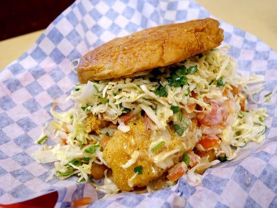 Pescado de cohete sandwich at Rocket Burger & Subs