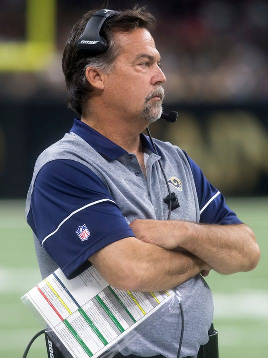 Los Angeles Rams head coach Jeff Fisher walks the sideline during an NFL football game against the New Orleans Saints in New Orleans, Sunday, Nov. 27, 2016. (Chris HellerThe Houma Daily Courier via AP)