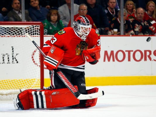 Chicago Blackhawks goalie Scott Darling (33) stops a shot by the Anaheim Ducks during the second period of an NHL hockey game Tuesday, Oct. 28, 2014, in Chicago. (AP Photo/Jeff Haynes)