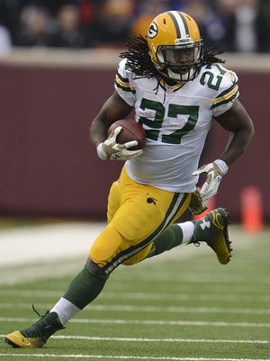 Green Bay Packers running back Eddie Lacy (27) runs with the ball against the Minnesota Vikings during Sunday's game at TCF Bank Stadium on the campus of the University of Minnesota in Minneapolis. Evan Siegle/Press-Gazette Media