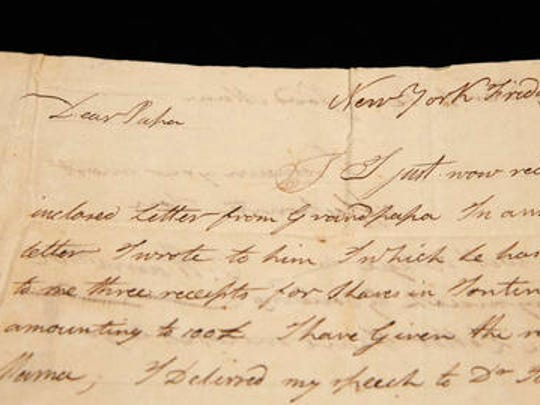 """A letter written by Alexander Hamilton's son Philip to his father begins with """"Dear Papa,"""" as displayed at Sotheby's, Tuesday, Jan. 10, 2017, in New York. Part of a trove of artifacts related to Alexander Hamilton including love letters to his wife, Eliza, the items are scheduled to go on the auction block Jan. 18. The dozens of letters penned by one of the nation's founding fathers belong to Hamilton's descendants. The documents have an estimated worth starting at $1.4 million and topping $2 million."""
