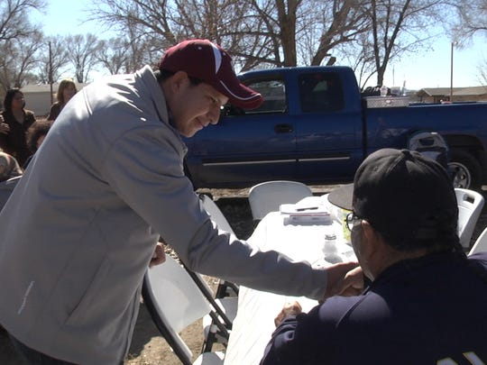 """A frame from """"Mayors of Shiprock"""" shows then Northern Diné Youth Committee member Adam J. Begaye meeting voters on election day in February 2015. Begaye was seeking a seat on the Central Consolidated School District Board of Education."""