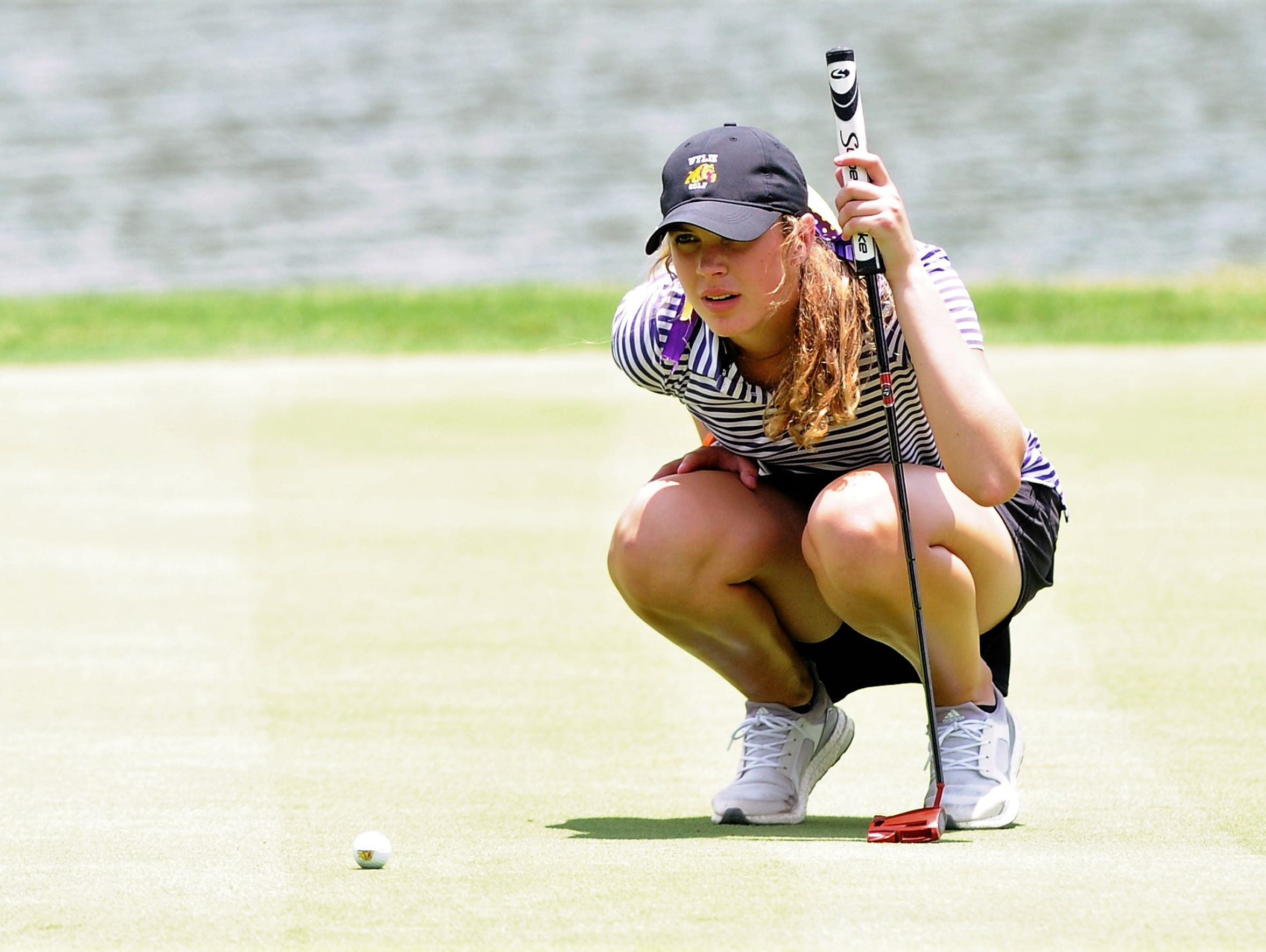 Wylie's Maddi Olson lines up a putt during the second round of the UIL Class 4A state tournament at the Slick Rock Golf Course at Horseshoe Bay in Marble Falls in May.