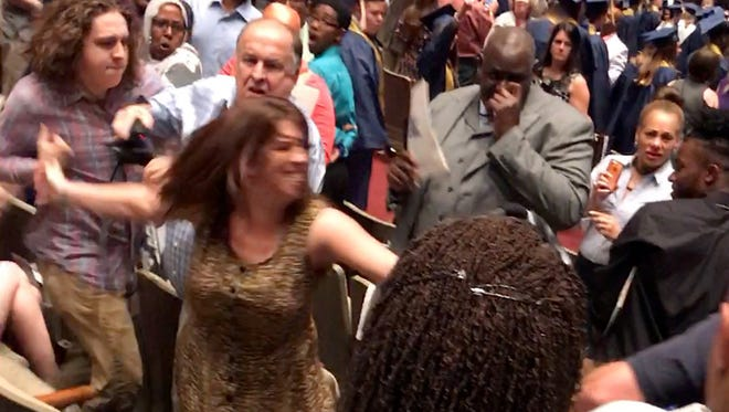 A fight during the Arlington High graduation was captured from numerous angles on cell phones.