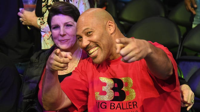 Nov 29, 2017; Los Angeles, CA, USA;  LaVar Ball (right) poses for cameras with his wife Tina (left) before game involving their son Los Angeles Lakers guard Lonzo Ball (not pictured) against the Golden State Warriors at Staples Center. Mandatory Credit: Richard Mackson-USA TODAY Sports ORG XMIT: USATSI-362531 ORIG FILE ID:  20171129_ggw_am8_004.JPG