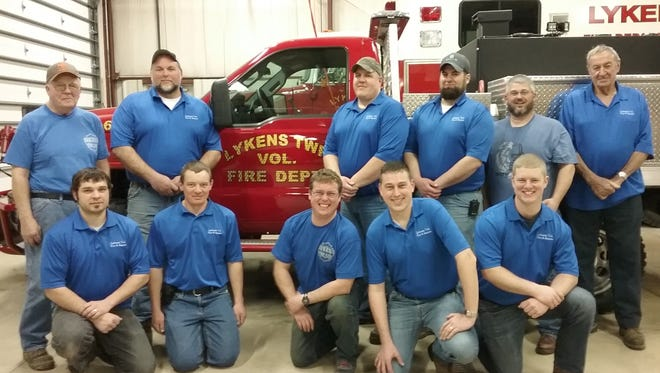 From left, front, areNick Seville, Greg Hartschuh, Jacob Schimpf, Marty Schuster and Phil Collene; and back,Paul Hartschuh, Chief Brad Schafer, Chris Stake, Assistant Chief Josh Schafer, Chad Gebhardtand Jerry Harer.