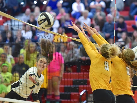 Mason's Maggie King spikes the ball past Ursuline's