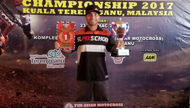 Sean Lipanovich poses with his first trophy and title. GMAC riders Sean Lipanovich and Stan Yashuiro represented Guam at the FIM Asian Motocross Championship, Round 1 and 2 in Kuala Terengganu, Malaysia March 23 to 25, 2017. Lipanovich took home first place in all four of his races and was named the standout rider against all of Asian FIMs best riders. Yashuiro finished fifth in the MX Veteran class.