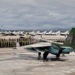 A photo provided by the Russian Defense Ministry shows Russian warplanes and military personnel at the the Hmeymim airbase, outside Latakia, Syria, on March 15, 2016. The first group of warplanes left the airbase after Russian President Vladimir Putin ordered the withdrawal of the majority of his country's troops from Syria.