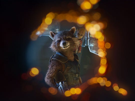 Rocket (voiced by Bradley Cooper) and Groot (Vin Diesel,