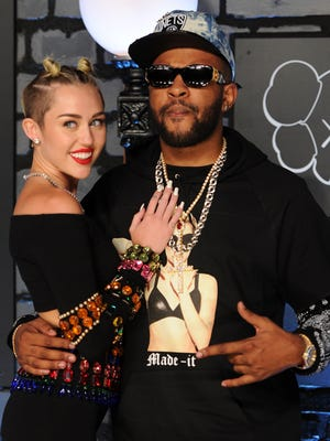 Miley Cyrus (left) and Mike Will Made It attend the MTV Video Music Awards at the Barclays Center on Aug. 25, 2013, in New York.