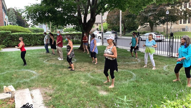 Rebeccah Sonn, from Salsa Worcester, leads a Salsa on the Lawn program on Aug. 9 at Clinton's Bigelow Free Public Library. The Salsa lessons, funded with a grant from the CHNA9, which focuses on healthy living programs, will host its final class of the fall on Thursday, Oct. 1.