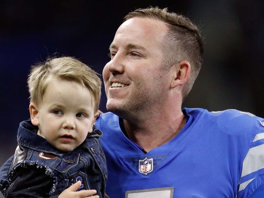 Oct 29, 2017; Detroit, MI, USA; Detroit Lions kicker Matt Prater (5) holds son Pax Prater before the game against the Pittsburgh Steelers at Ford Field. Mandatory Credit: Raj Mehta-USA TODAY Sports
