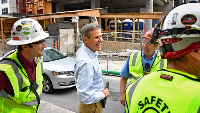 Williamson County businessman Bill Lee talks with a few of his employees who are working on a building under construction at Fifth and Church in downtown Nashville April 23, 2017.