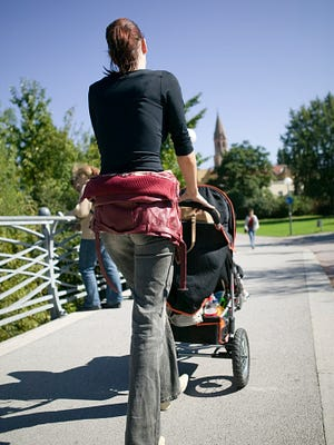 Woman pushes stroller